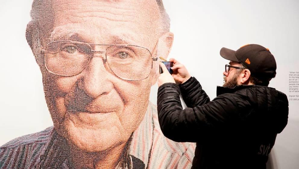 A visitor takes a mobile photo of a picture of Ingvar Kamprad, founder of Swedish multinational furniture retailer IKEA, at t