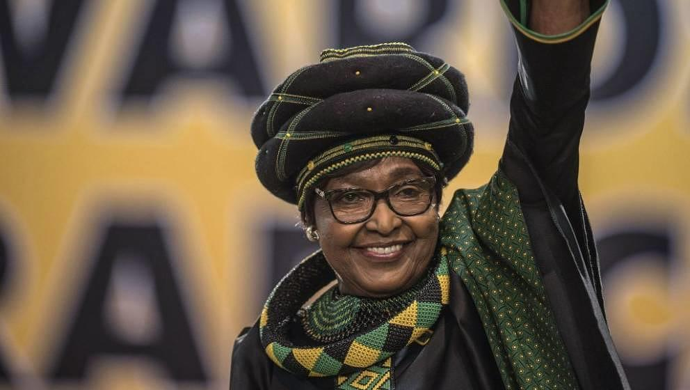 The former wife of the late South African President Nelson Mandela, anti-apartheid campaigner Winnie Mandela waves as she att