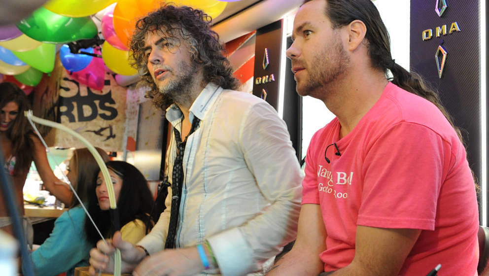 BILOXI, MS - JUNE 28:  Wayne Coyne of The Flaming Lips and Chris Pontius of Jackass on the bus during the MTV, VH1, CMT &