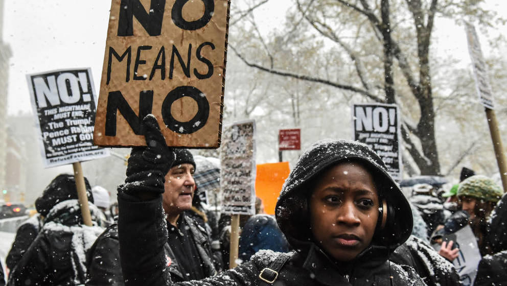 NEW YORK, NY - DECEMBER 09: People carry signs addressing the issue of sexual harassment at a #MeToo rally outside of Trump I