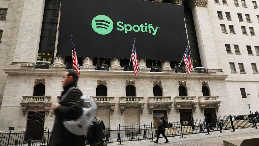 NEW YORK, NY - APRIL 03:  The Spotify banner hangs from the New York Stock Exchange (NYSE) on the morning that the music stre