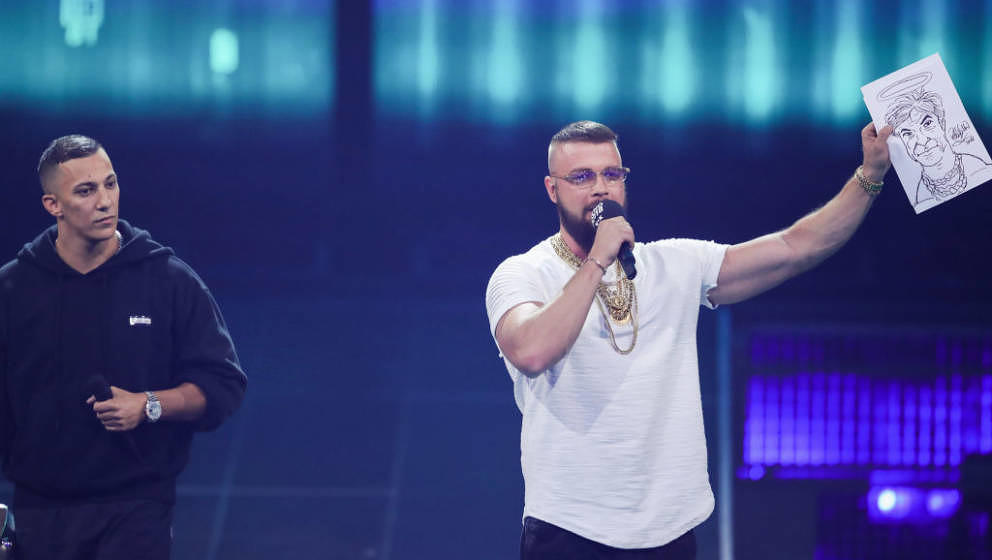 BERLIN, GERMANY - APRIL 12:  'Hip-Hop/Urban - National' award winners Farid Bang and Kollegah speak on stage during the Echo