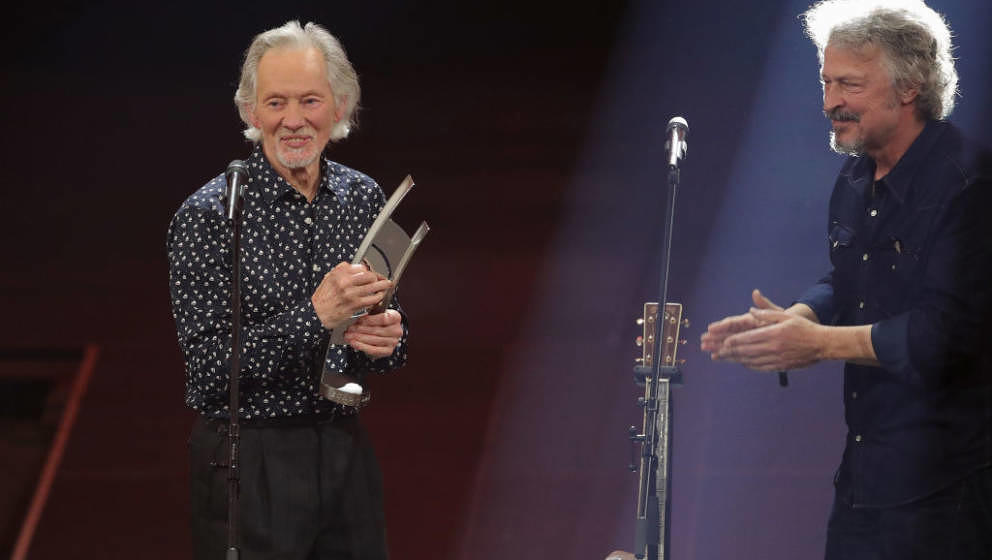 BERLIN, GERMANY - APRIL 12:  (L-R) Klaus Voormann receives the 'Lifeswork' award by Wolfgang Niedecken on stage during the Ec