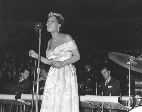 Billie Holiday, performs on stage, 14 February 1954. (Photo by Harry Hammond/V&A Images/Getty Images)