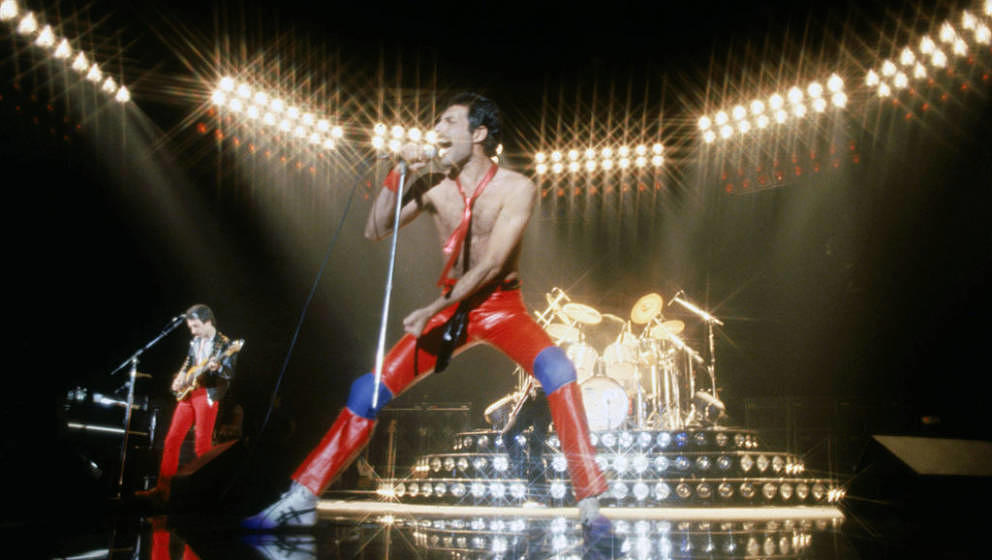 From left to right, musician John Deacon and Freddie Mercury (1946 - 1991) of British rock band Queen in concert, 1980. (Phot