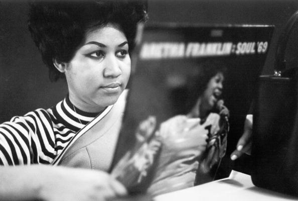NEW YORK - JANUARY 09: Soul singer Aretha Franklin reviews a copy of her album 'Aretha Franklin - Soul '69' at Atlantic Recor