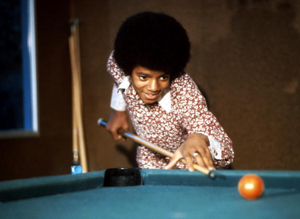 LOS ANGELES - CIRCA 1972: Singer Michael Jackson of the R&B quintet 'Jackson 5' plays pool at home in 1972 in Los Angeles