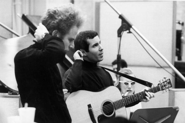 NEW YORK - CIRCA 1967: Singer/songwriter Paul Simon (right) and singer Art Garfunkel of the folk rock duo Simon & Garfunk