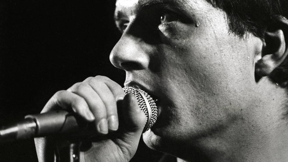 NETHERLANDS - JANUARY 16:  ROTTERDAM  Photo of Joy Division, Ian Curtis performing live onstage at the Lantaren  (Photo by Ro