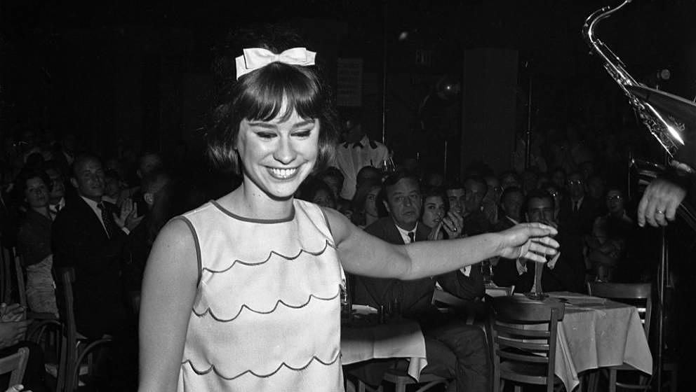 NEW YORK - AUGUST 19: Jazz singer Astrud Gilberto leaves the stage at Birdland on the day they recorded the live album Getz A