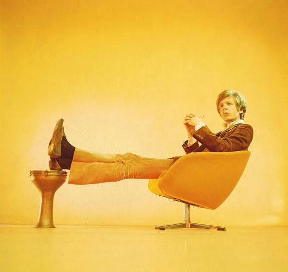 UNSPECIFIED - JANUARY 01:  Photo of Scott WALKER; Scott Walker (Scott Engel) posed, studio, sitting on 1960s chair, solo era