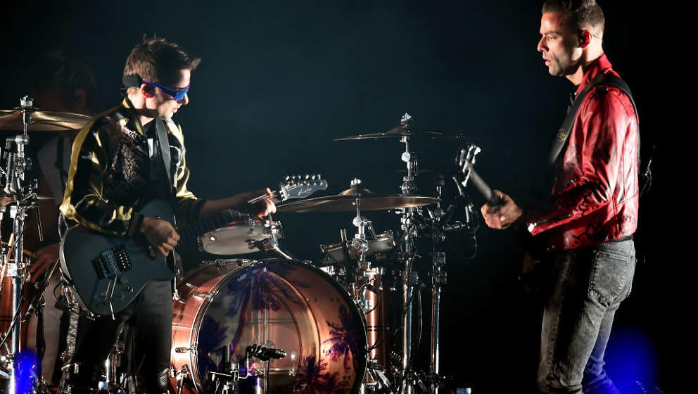 INGLEWOOD, CA - DECEMBER 09:  (L-R) Matt Bellamy and Chris Wolstenholme of Muse perform onstage during KROQ Almost Acoustic C