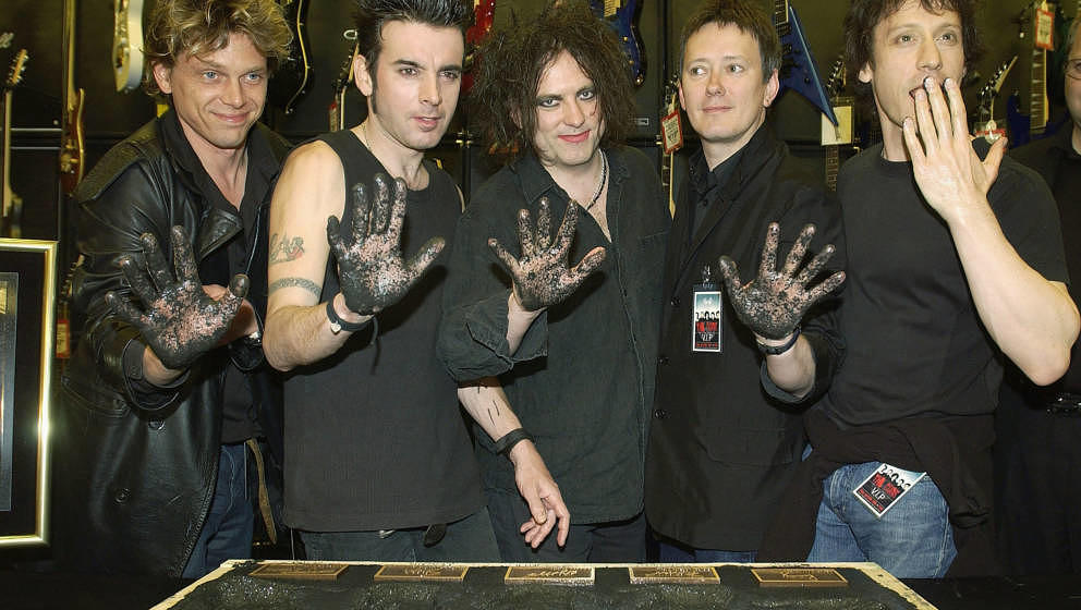 HOLLYWOOD - APRIL 30:  Members of the English rock band The Cure (from left): Jason Cooper, Simon Gallup, Robert Smith, Roger