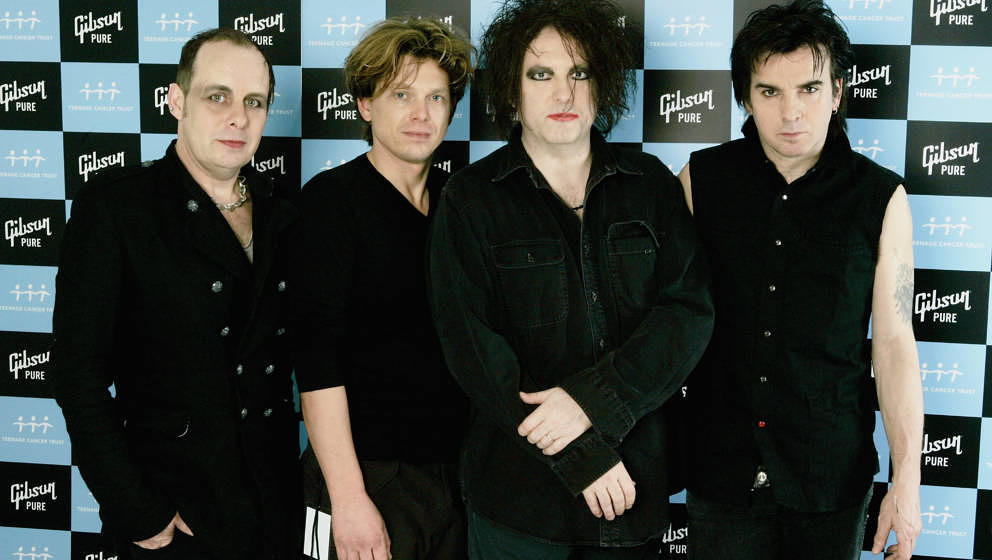 LONDON - APRIL 01:  (L-R) Porl Thompson, Jason Cooper, Robert Smith and Simon Gallup of The Cure pose backstage on the sixth