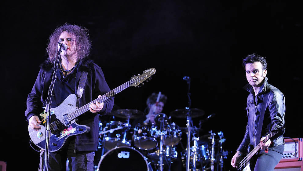 INDIO, CA - APRIL 19: Lead Vocalist Robert Smith, Drummer Jason Cooper and Bassist Simon Gallup of The Cure performs during t