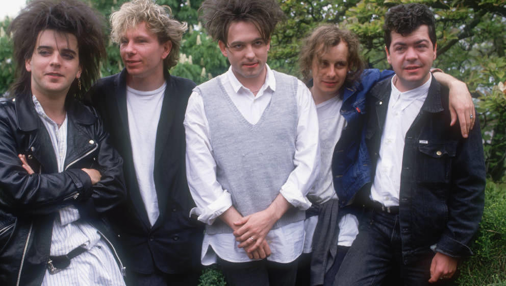 British group The Cure in 1987, the year they released the double album 'Kiss Me, Kiss Me, Kiss Me'. From left to right, they