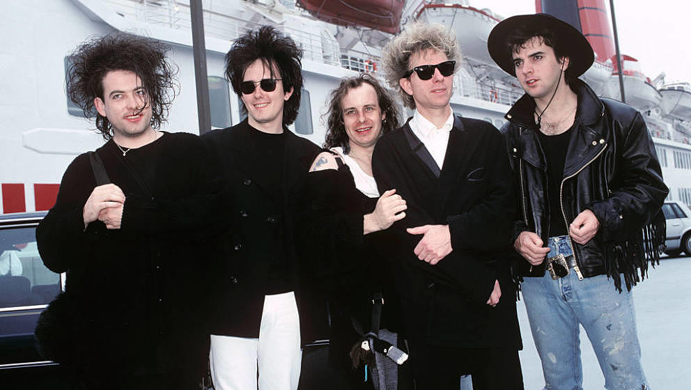 The Cure arrive in America on the QE2 at Pier 90 in New York City on August 20, 1989. (L-R) Robert Smith, Roger O'Donnell, Po