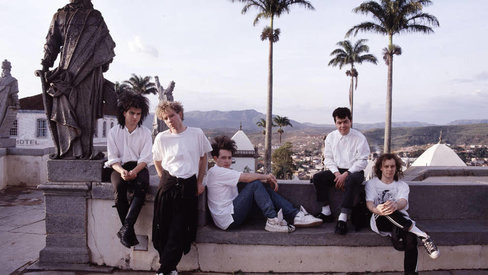 English rock band The Cure in Brazil, 1987. From left to right, they are bass player Simon Gallup, drummer Boris Williams, vo