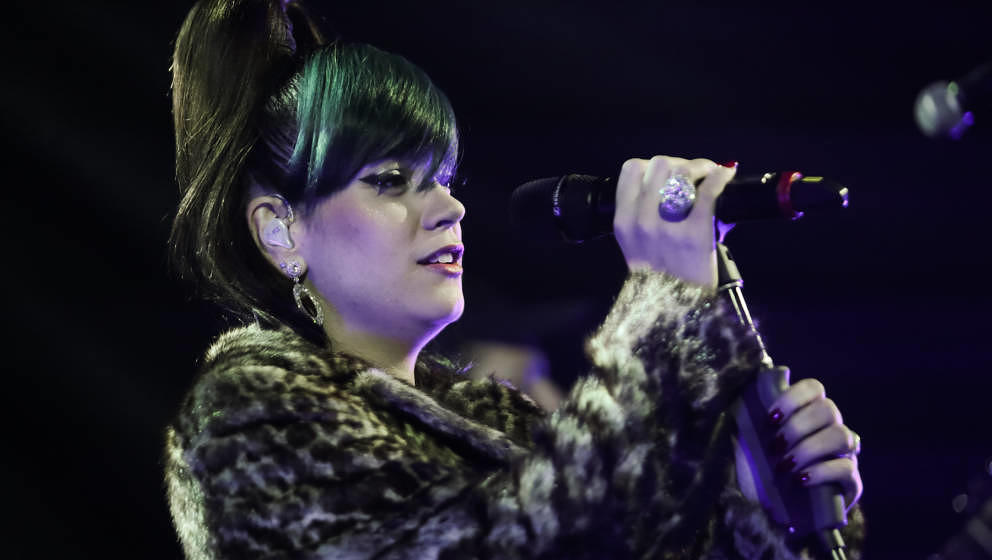 LONDON, UNITED KINGDOM - DECEMBER 19: Lily Allen performs at the 'Under 1 Roof' concert in aid of Kids Company at Hammersmith
