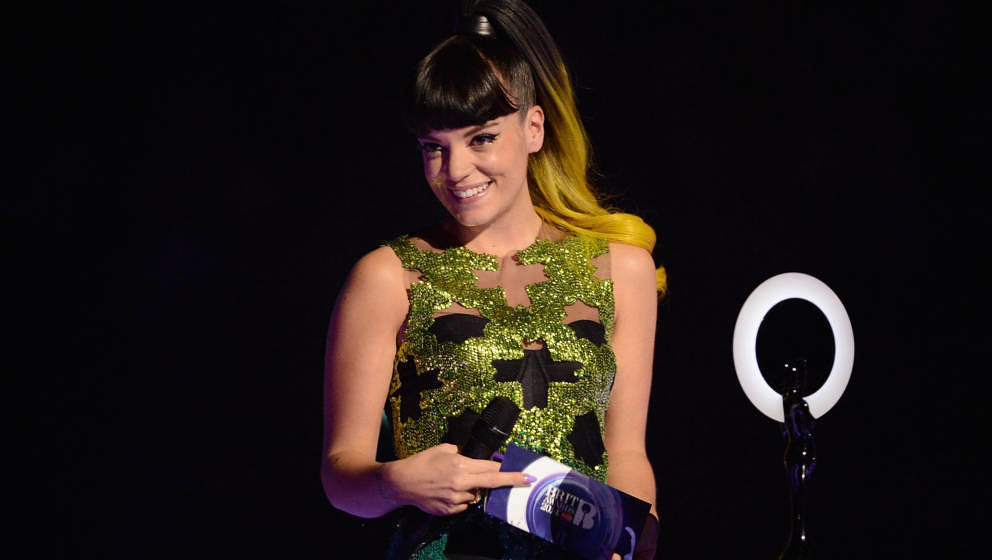 LONDON, ENGLAND - FEBRUARY 19:  Lily Allen presents the award for British Group at The BRIT Awards 2014 at 02 Arena on Februa