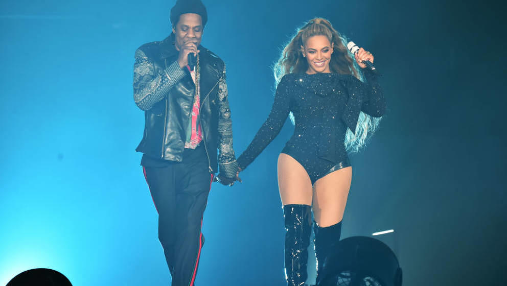 GLASGOW, SCOTLAND - JUNE 09:  Beyonce and Jay-Z perform together holding hands on stage during the 'On the Run II' Tour at Ha
