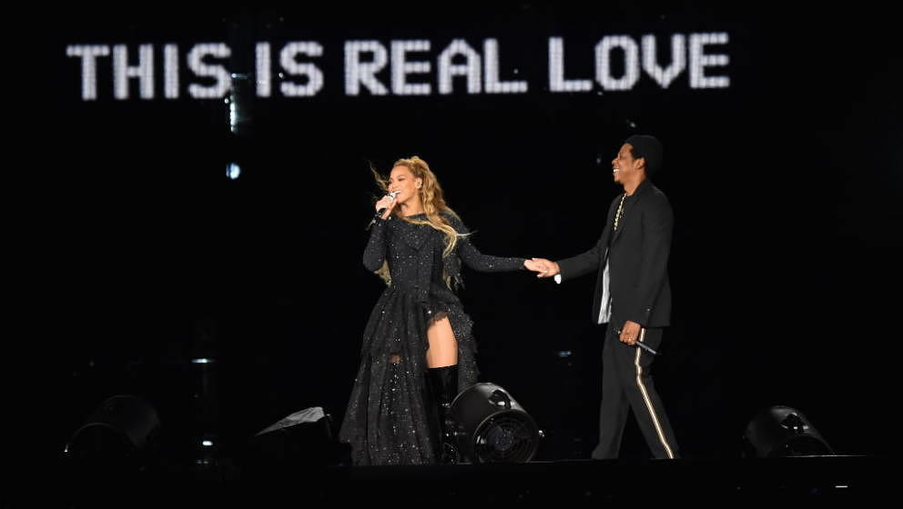 GLASGOW, SCOTLAND - JUNE 09:  Beyonce and Jay-Z hold hands ending their performance on stage during the 'On the Run II' Tour