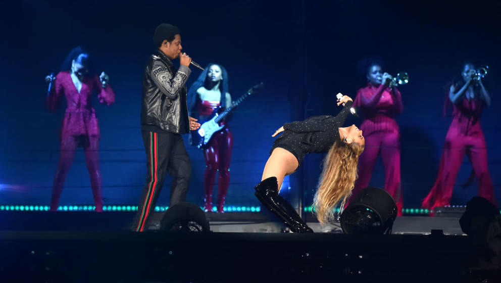GLASGOW, SCOTLAND - JUNE 09:  Beyonce bends back as she and Jay-Z perform together on stage during the 'On the Run II' Tour a