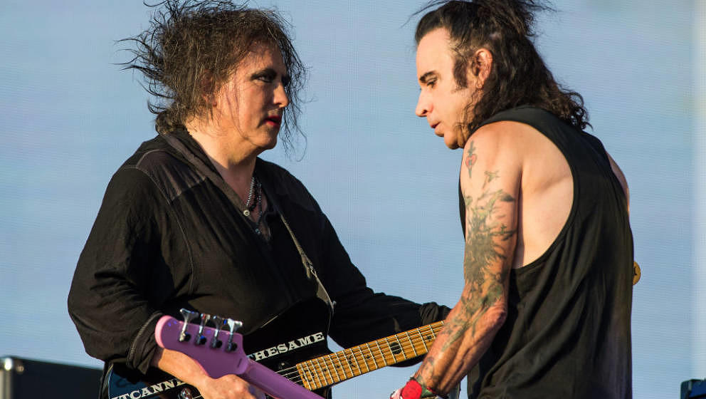 LONDON, ENGLAND - JULY 07: Robert Smith (L) and Simon Gallup of The Cure perform live at  Barclaycard present British Summer