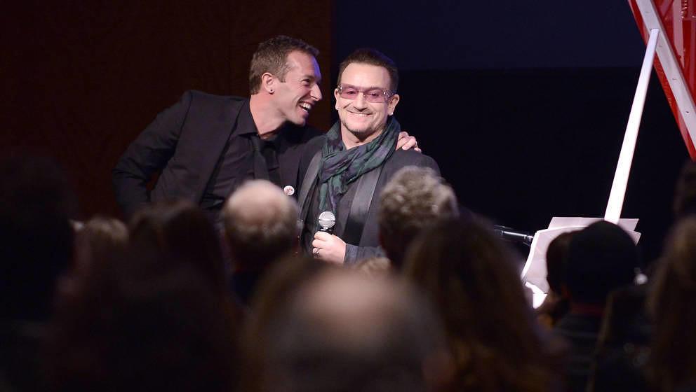 Haben finanziell beide gut lachen: Chris Martin (Coldplay) und Bono Vox (U2)