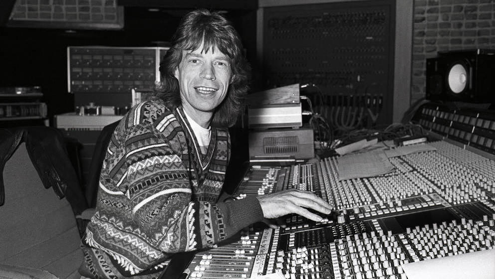 HILVERSUM, NETHERLANDS - 12th DECEMBER: Mick Jagger from The Rolling Stones sits at the mixing desk in Wisseloord Studios, Hi