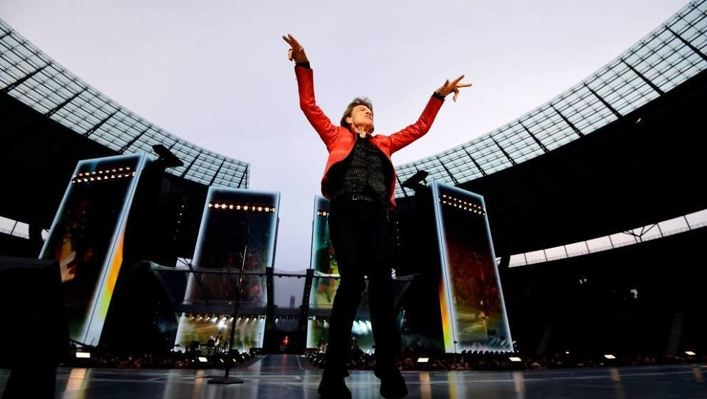 Singer of British band the Rolling Stones, Mick Jagger performs with the band during a  concert at Berlin's Olympic Stadium o