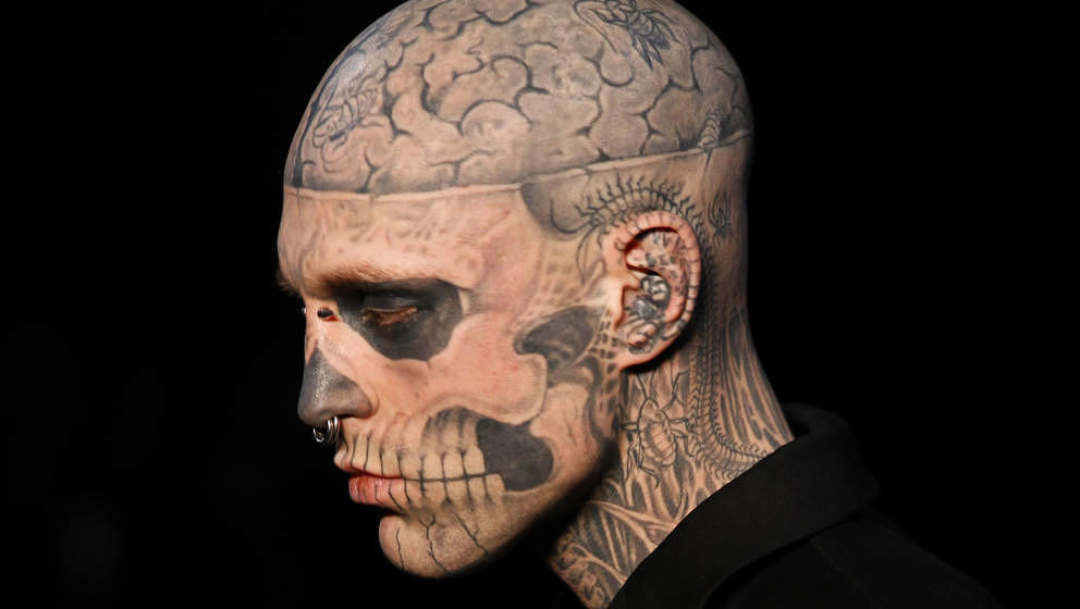 Canadian model Rick Genest aka Zombie boy presents a creation by French designer Thierry Mugler during the Men's fall-winter