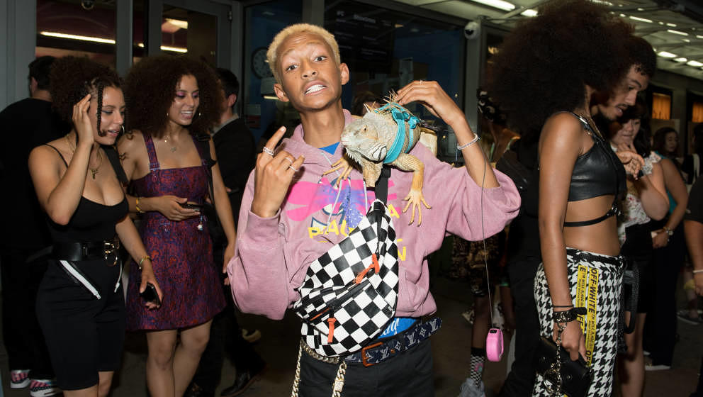 NEW YORK, NY - AUGUST 07:  Jaden Smith poses with an Iguana at the 'Skate Kitchen' New York premiere at IFC Center on August