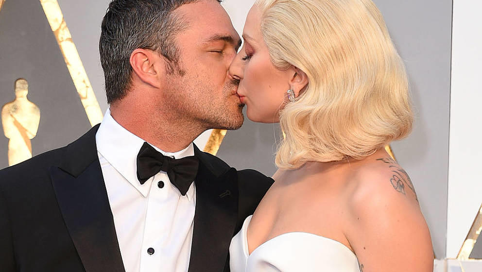HOLLYWOOD, CA - FEBRUARY 28:  Taylor Kinney and Lady Gaga arrives at the 88th Annual Academy Awards at Hollywood & Highla