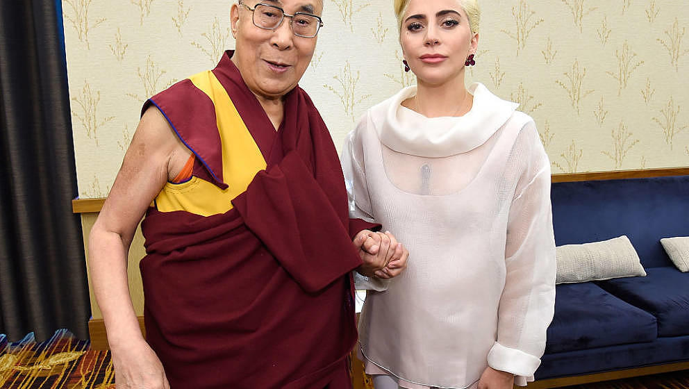 INDIANAPOLIS, IN - JUNE 26:  (Exclusive Coverage) Lady Gaga (R) joins his Holiness the Dalai Lama (L) to speak to US Mayors a