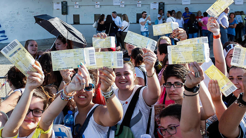 TURIN, ITALY - 2015/05/10: Hundreds of fans, under a hot sun, show tickets for the concert of Italian singer Marco Mengoni. (