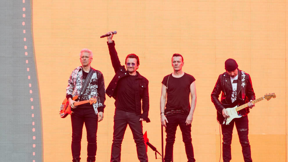 LONDON, ENGLAND - JULY 08:  Adam Clayton (L) , Bono, Larry Mullen Jr. and The Edge of U2 performing at Twickenham Stadium on