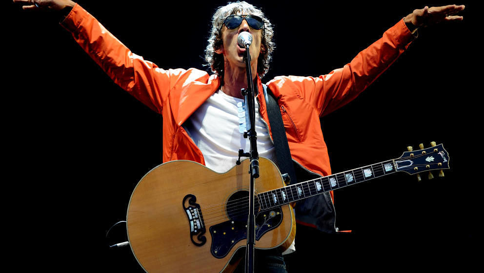 MANCHESTER, ENGLAND - AUGUST 18:  Richard Ashcroft performs supporting Liam Gallagher at Emirates Old Trafford on August 18,