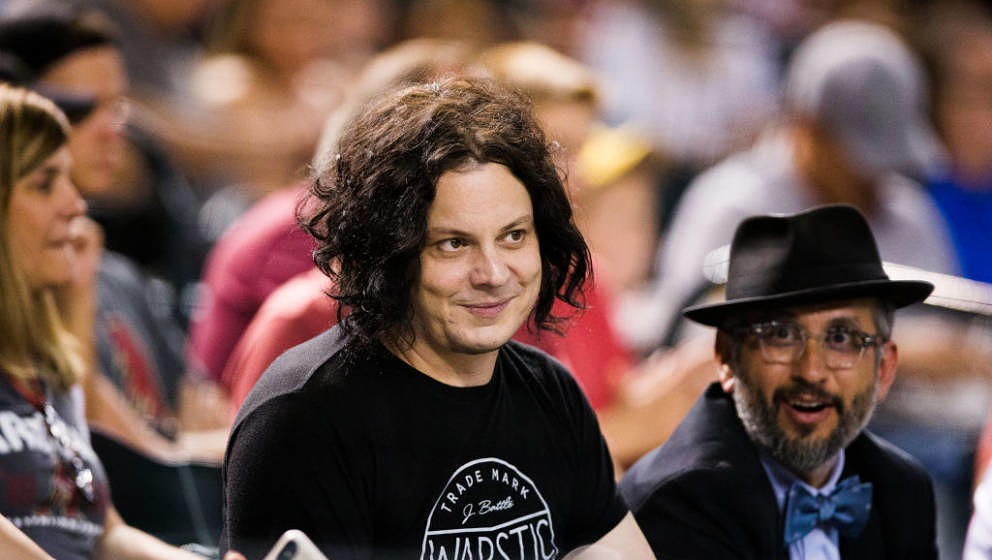 PHOENIX, AZ - AUGUST 22: Jack White from The White Stripes watches an MLB game between the Arizona Diamondbacks and Los Angel