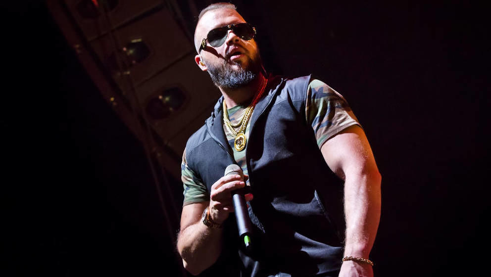 BERLIN, GERMANY - JANUARY 18: German rapper Kollegah performs live on stage during a concert at the Columbiahalle on January