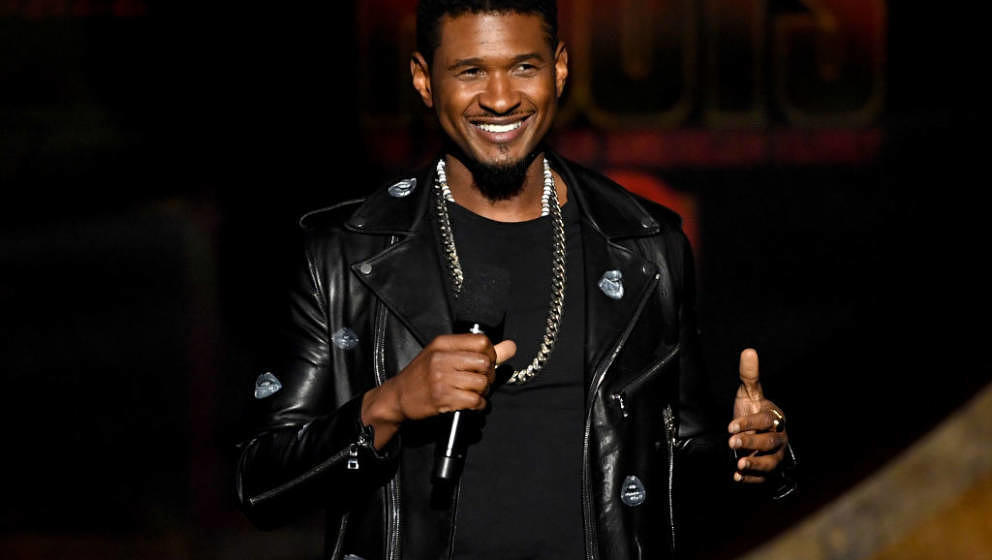 LOS ANGELES, CA - SEPTEMBER 25:  Usher speaks onstage at Q85: A Musical Celebration for Quincy Jones at the Microsoft Theatre