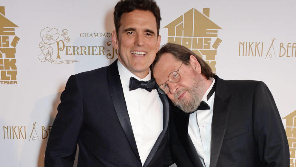 CANNES, FRANCE - MAY 14:  Matt Dillon (L) and director Lars von Trier pose at Nikki Beach for the Perrier Jouet celebration o