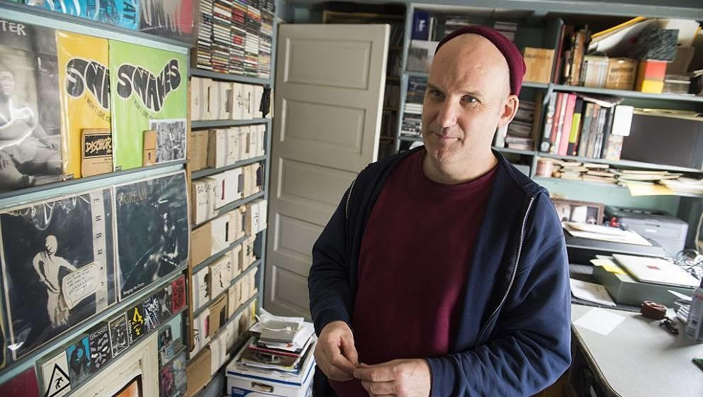 Ian MacKaye, founder of Dischord Records and former Fugazi member, speaks in his office in Arlington, Virginia, March 25, 201