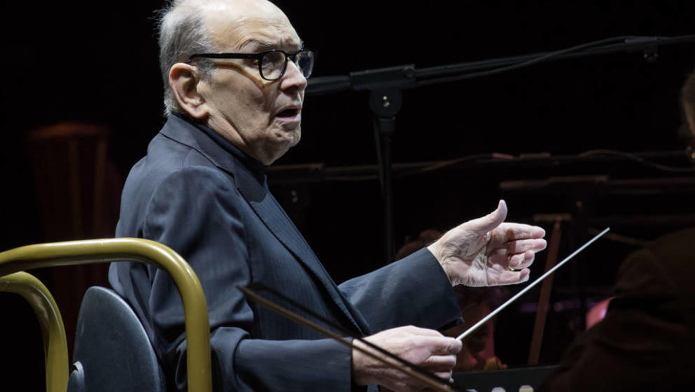 MILAN, ITALY - MARCH 06:  Ennio Morricone performs on stage at Mediolanum Forum on March 6, 2018 in Milan, Italy.  (Photo by