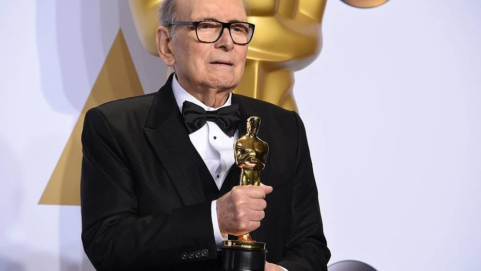 Composer Ennio Morricone poses with the Oscar for Best Original Score, 'The Hateful Eight,' in the press room during the 88th