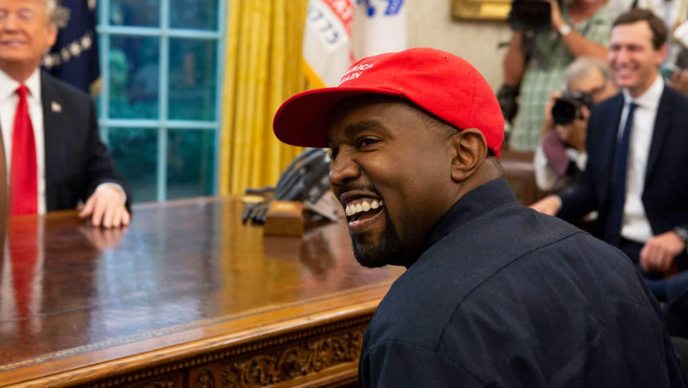 WASHINGTON, DC - OCTOBER 11: Rapper Kanye West laughs during a meeting with President Donald Trump in the Oval Office of the