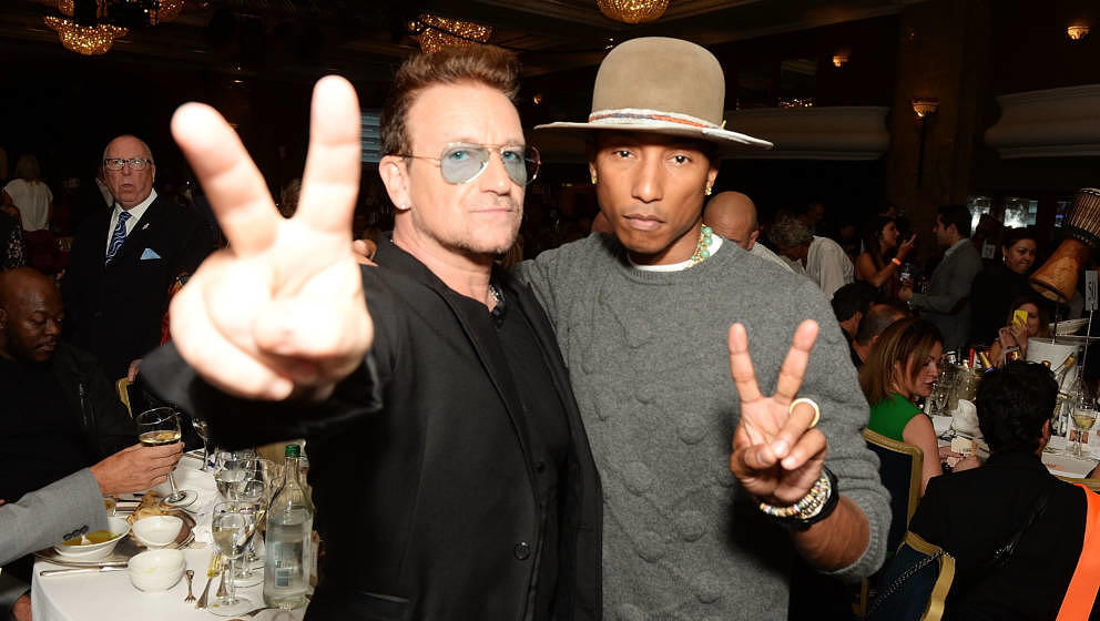 LONDON, ENGLAND - JULY 04:  Bono and Pharrell Williams attend the Nordoff Robbins 02 Silver Clef awards at London Hilton on J