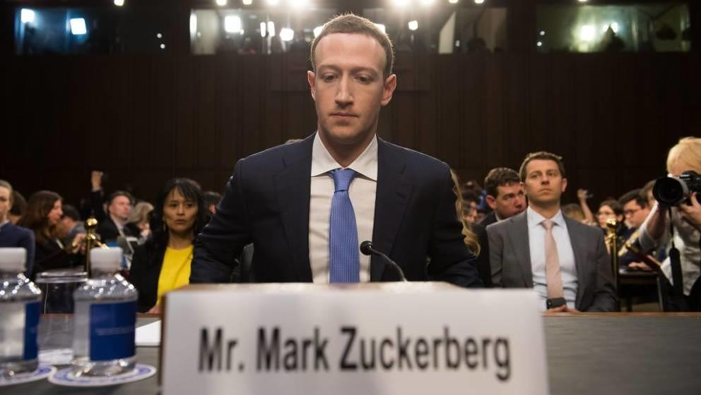 Facebook founder and CEO Mark Zuckerberg arrives to testify following a break during a Senate Commerce, Science and Transport