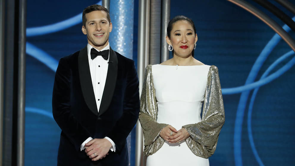 BEVERLY HILLS, CALIFORNIA - JANUARY 06: In this handout photo provided by NBCUniversal, Hosts Andy Samberg and Sandra Oh spea
