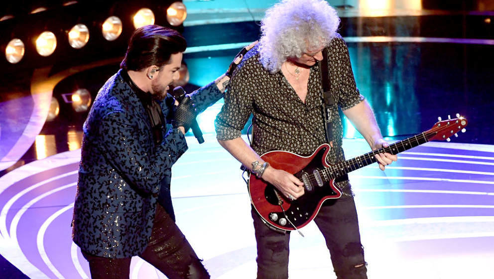 HOLLYWOOD, CALIFORNIA - FEBRUARY 24: (L-R) Adam Lambert and Brian May of Queen perform onstage during  onstage during the 91s